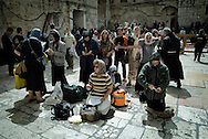 Worshippers pray outside the Church of the Holy Sepulchre in Jerusalem's Old city April 3, 2010