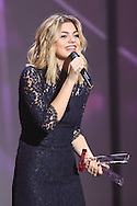 "PARIS, FRANCE - FEBRUARY 12:  Louane receives an award during ""Les Victoires De La Musique"" at Le Zenith on February 12, 2016 in Paris, France.  (Photo by Tony Barson/FilmMagic)"