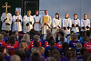 Pilgrims await arrival of Pope at Hyde Park rally during Pope Benedict XVI's papal tour of Britain 2010, the first visit by a pontiff since 1982. Taxpayers footed the £10m bill for non-religious elements, which largely angered a nation still reeling from the financial crisis. Pope Benedict XVI is the head of the biggest Christian denomination in the world, some one billion Roman Catholics, or one in six people. In Britain there are about five million Catholics but only a quarter of Catholics regularly attend Sunday Mass and some churches have closed owing to spending cuts.