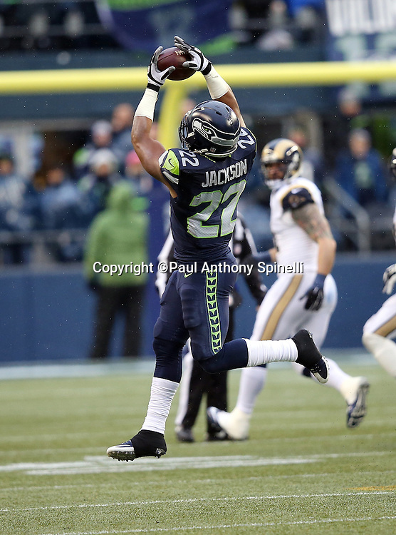 Seattle Seahawks running back Fred Jackson (22) jumps and catches a pass during the 2015 NFL week 16 regular season football game against the St. Louis Rams on Sunday, Dec. 27, 2015 in Seattle. The Rams won the game 23-17. (©Paul Anthony Spinelli)