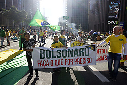 May 26, 2019 - Sao Paulo, Brazil - Supporters of Brazilian President Jair Bolsonaro demonstrate along Paulista Avenue in Sao Paulo on May 26, 2019 to shore up the ultraconservative government as it faces growing opposition, while marches are planned across Brazil. - Bolsonaro, who took power in January on a promise to revive Latin America's biggest economy, has seen his popularity plunge as rising unemployment and education spending freezes fuel opposition to his administration, which is plagued by infighting. (Credit Image: © Cris Faga/NurPhoto via ZUMA Press)