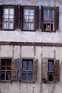 SAFRANBOLU, TURKEY AUGUST 2003. A boy looks out of the window of a traditional house. The city of Safranbolu positioned in the forests on the Black Sea coast is one of the world heritage sites of the UNESCO. Apart from its Ottoman era wood and mudbrick houses it is also known for its 'Lokum' or Turkish delight. A delicate sweets with flavours from nuts to rose petals. Photo by Frits Meyst/Adventure4ever.com