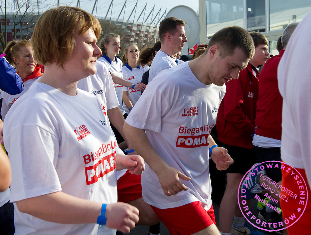 Trainers and athletes of Special Olympics attend attend a 3330 meters run one day before Warsaw Orlen Marathon on April 20, 2013..The mission of Special Olympics is to provide sports training and athletic competition for children and adults with intellectual disabilities...Poland, Warsaw, April 20, 2013..Picture also available in RAW (NEF) or TIFF format on special request...For editorial use only. Any commercial or promotional use requires permission...Photo by © Adam Nurkiewicz / Mediasport
