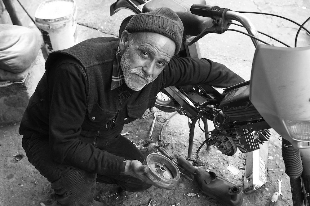 A Kurdish man at work in his motorcycle repairshop in the old city of Diyarbakir, southeastern Turkey.