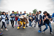 Los Angeles Rams mascot Rampage interacts with students during community improvement project at Belvedere Elementary School to upgrade play and social spaces around the school by building a new playground structure, painting murals and basketball backboards and landscaping., Friday, June 14, 2019, in Los Angeles, Calif. (Ed Ruvalcaba/Image of Sport)