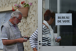 June 11, 2017 - Hottot-Les-Bagues, France - French citizens arrive to the Polling Station to cast their votes in Hottot-Les-Bagues town hall...French legislative elections are scheduled to take place on 11 and 18 June (with different dates for voters overseas) to elect the 577 members of the 15th National Assembly of the French Fifth Republic. According to the final list published by the Ministry of the Interior on 23 May, a total of 7,882 candidates are standing in the legislative elections..On Sunday, June 11, 2017, in Hottot-Les-Bagues, Calvados, France. (Credit Image: © Artur Widak/NurPhoto via ZUMA Press)