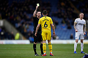Jamie Hanson of Oxford United receives a fellow card during the EFL Sky Bet League 1 match between Oxford United and Peterborough United at the Kassam Stadium, Oxford, England on 16 February 2019.