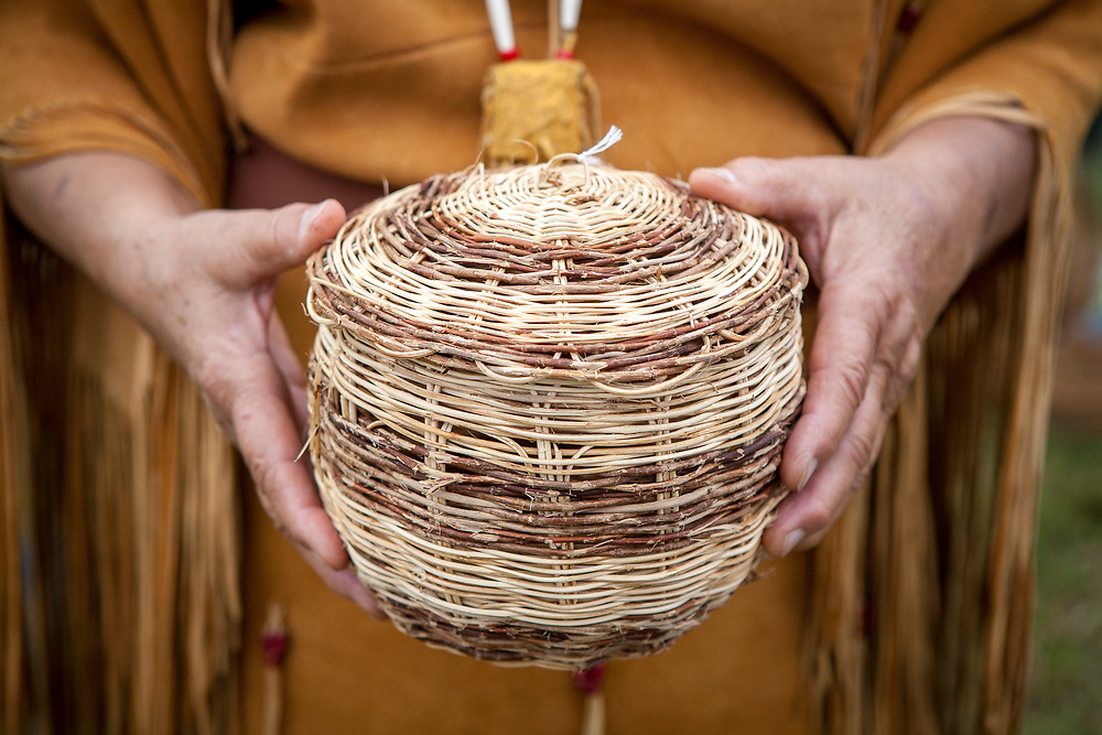 Bertie Branham holds one of her handwoven Honeysuckle baskets at the Fall Festival in Evergreen, VA, on Saturday, October 19, 2013. She is the last basketweaver in the Monacan tribe, although she currently is teaching it to her granddaughter.