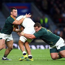 LONDON, ENGLAND - NOVEMBER 03: Jesse Kriel and Wilco Louw of South Africa tackling Zach Mercer of England during the Castle Lager Outgoing Tour match between England and South Africa at Twickenham Stadium on November 03, 2018 in London, England. (Photo by Steve Haag/Gallo Images)