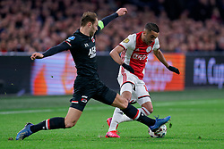 Hakim Ziyech #22 of Ajax and Teun Koopmeiners #8 of AZ Alkmaar in action during the Dutch Eredivisie match round 25 between Ajax Amsterdam and AZ Alkmaar at the Johan Cruijff Arena on March 01, 2020 in Amsterdam, Netherlands