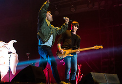 © Licensed to London News Pictures. 13/06/2015. Isle of Wight, UK.   Blur performing live at Isle of Wight Festival 2015, Day 3 Saturday,headlining the main stage.   In this picture -  Damon Albarn (left), Alex James (right).  Headline acts include The Prodigy, Blur and Fleetwood Mac.   Photo credit : Richard Isaac/LNP