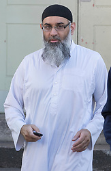 © Licensed to London News Pictures. 19/10/2018. London, UK. Radical preacher ANJEM CHOUDARY emerges from a bail hostel holding a mobile phone after being released form Belmarsh Prison in south-east London. Photo credit: Peter Macdiarmid/LNP