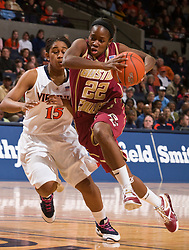 Boston Coll. guard Brittanny Johnson (22) makes a power move in the lane past Virginia guard Ariana Moorer (15).  The #21 ranked Virginia Cavaliers defeated the Boston College Eagles 90-70 at the John Paul Jones Arena in Charlottesville, VA on February 22, 2009.