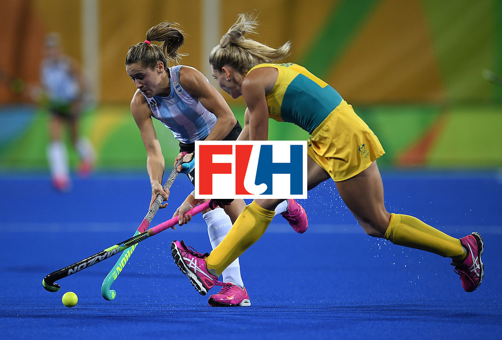 Argentina's Martina Cavallero and Australia's Casey Sablowski fight for the ball during the women's field hockey Australia vs Argentina match of the Rio 2016 Olympics Games at the Olympic Hockey Centre in Rio de Janeiro on August, 11 2016. / AFP / MANAN VATSYAYANA        (Photo credit should read MANAN VATSYAYANA/AFP/Getty Images)