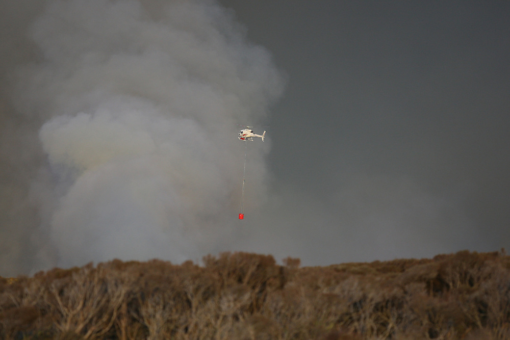 One of the three helicopters at the fire burning near Awarua Wetlands, Invercargill, New Zealand, Monday, November 19, 2012. Credit:SNPA / Dianne Manson.