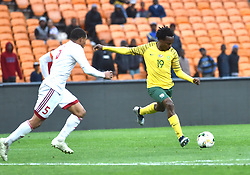 South Africa: Johannesburg: Bafana Bafana player Percy Tau takes a shot during Seychelles player Jones Joburt for the Africa Cup Of Nations qualifiers at FNB stadium, Gauteng.<br />