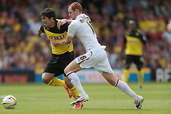 Watford's Fernando Forestieri is fouled by Bournemouth's Shaun MacDonald  - Photo mandatory by-line: Nigel Pitts-Drake/JMP - Tel: Mobile: 07966 386802 10/08/2013 - SPORT - FOOTBALL - Vicarage Road - Hertfordshire -  Watford v AFC Bournemouth - Sky Bet Championship