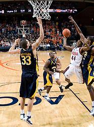 Virginia guard Sean Singletary (44) shoots over Drexel forward Evan Neisler (33).  The #23 Virginia Cavaliers men's basketball team defeated Drexel Dragons 72-58 at the John Paul Jones Arena in Charlottesville, VA on November 20, 2007.
