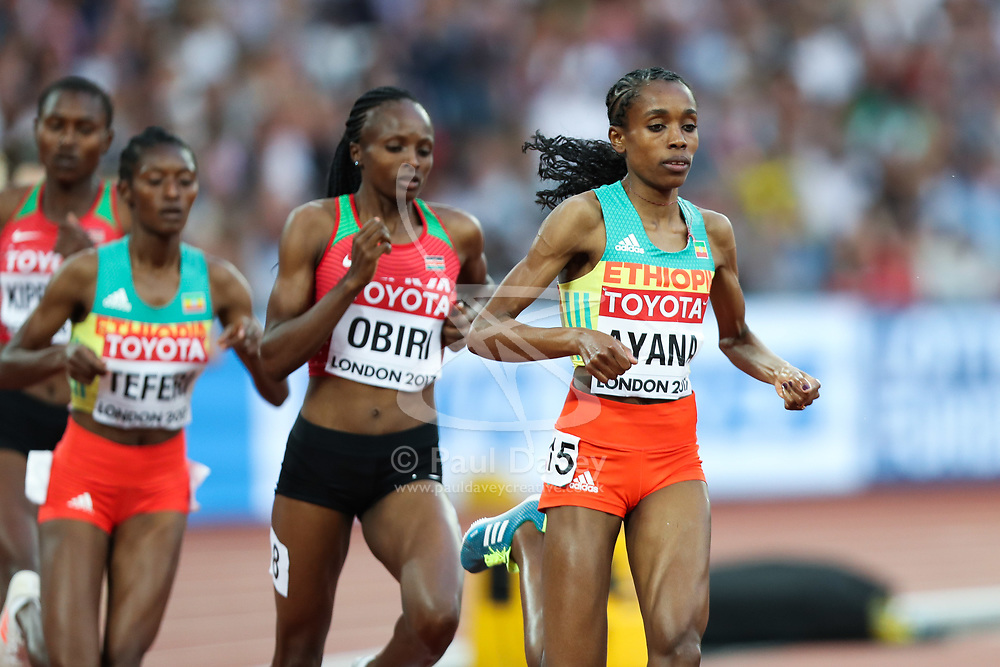 London, August 13 2017 . Almaz Ayana, Ethiopia, and Hellen Onsando Obiri, Kenya, break from the pack in the women's 5000m final on day ten of the IAAF London 2017 world Championships at the London Stadium. © Paul Davey.