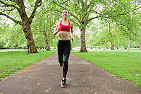 Full length of fit young woman jogging in park