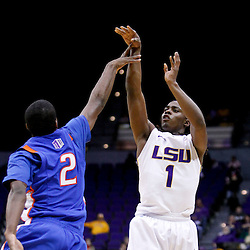 December 10, 2011; Baton Rouge, LA; LSU Tigers guard Anthony Hickey (1) shoots over Boise State Broncos guard Derrick Marks (2) during the first half of a game at the Pete Maravich Assembly Center.  Mandatory Credit: Derick E. Hingle-US PRESSWIRE