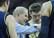 January 14, 2011: Michigan Wolverines head coach John Beilein talks to his players during a timeout in the NCAA basketball game between the Michigan Wolverines and the Iowa Hawkeyes at Carver-Hawkeye Arena in Iowa City, Iowa on Saturday, January 14, 2011. Iowa defeated Michigan 75-59.