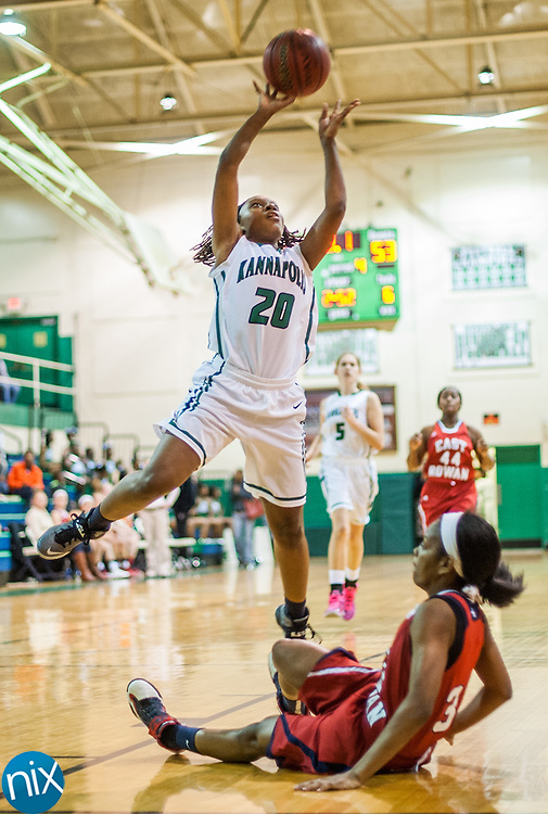 Kannapolis' Aitana Grant goes up for a shot over East Rowan's Shenique Pharr Friday night at A.L. Brown High School. Kannapolis won the game 62-58.