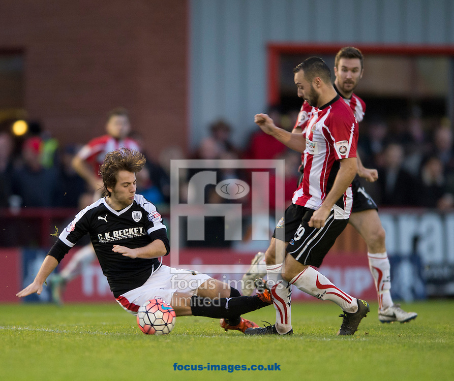 Ben Pearson of Barnsley (left) makes a challenge on Ryan Crowther of Altrincham during the FA Cup match at Moss Lane, Altrincham<br /> Picture by Russell Hart/Focus Images Ltd 07791 688 420<br /> 07/11/2015