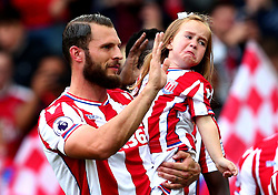 A mascot looks upset as she is carried out onto the pitch by Erik Pieters of Stoke City - Mandatory by-line: Robbie Stephenson/JMP - 19/08/2017 - FOOTBALL - Bet365 Stadium - Stoke-on-Trent, England - Stoke City v Arsenal - Premier League