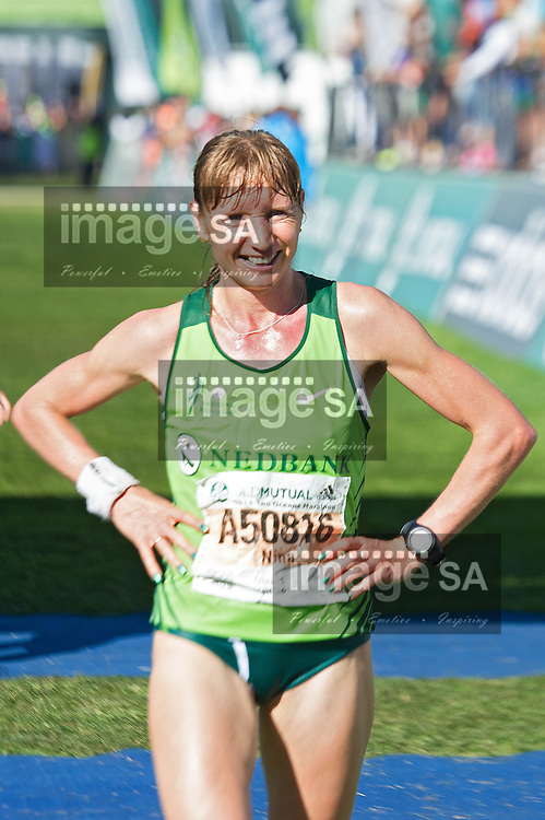 CAPE TOWN, South Africa - Saturday 19 April 2014, Womens first place winner Nina Podnebesnova during the ultra marathon of the Old Mutual Two Oceans Marathon. <br /> Photo by Luigi Bennett/ ImageSA