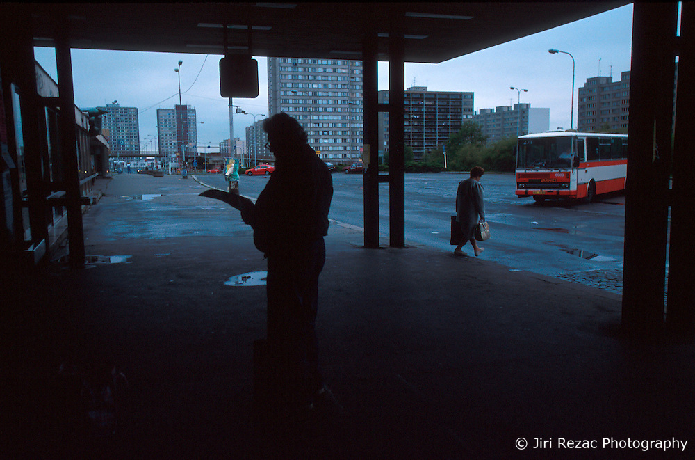 CZECH REPUBLIC PRAGUE JUL00 - A man waits for the  bus at Haje statioin in southern Prague, dominated by concrete block type architecture symptomatic of Socialist Functionalism. . . jre/Photo by Jiri Rezac.  . © Jiri Rezac 2000. . Tel:   +44 (0) 7050 110 417. Email: info@jirirezac.com. Web:   www.jirirezac.com