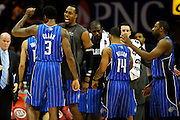 Dec. 28, 2010; Cleveland, OH, USA; Orlando Magic forward Earl Clark (3) celebrates with Orlando Magic center Dwight Howard (12) during a timeout during the fourth quarter against the Cleveland Cavaliers at Quicken Loans Arena. The Magic beat the Cavaliers 110-95. Mandatory Credit: Jason Miller-US PRESSWIRE