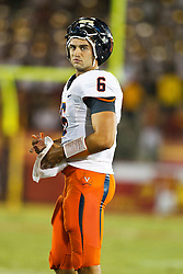 September 11, 2010; Los Angeles, CA, USA;  Virginia Cavaliers quarterback Marc Verica (6) during a time out against the Southern California Trojans during the fourth quarter at the Los Angeles Memorial Coliseum.  USC defeated Virginia 17-14.