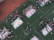 CHONGQING, CHINA - JUNE 08: (CHINA OUT) <br /> <br /> More than one thousand students stand around group photos during their graduation ceremony at Yangjiaping high school on June 8, 2015 in Chongqing, China. All group photos were cut to pieces and each student took one piece, the school hopes that the students could come back ten years later and piece together the group photos. <br /> ©Exclusivepix Media