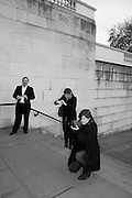 GREGOR MUIR, JANE AND LOUISE WILSON, INTERCOURSE: Re-enacting Eisenstein: The Odessa Steps Sequence from Battleship Potemkin<br /> Jane and Louise Wilson directed the re-enactment on the steps outside the ICA. 26 November 2011.