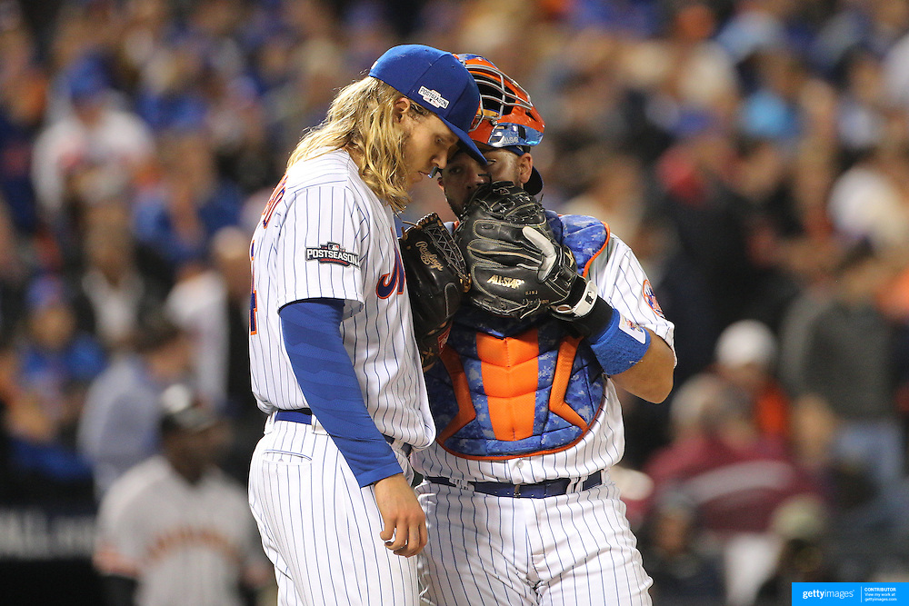 NEW YORK, NEW YORK - October 5: Pitcher Noah Syndergaard #34 of the New York Mets with catcher Rene Rivera #44 of the New York Mets while pitching during the San Francisco Giants Vs New York Mets National League Wild Card game at Citi Field on October 5, 2016 in New York City. (Photo by Tim Clayton/Corbis via Getty Images)