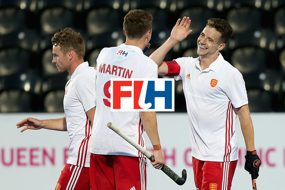 LONDON, ENGLAND - JUNE 20:  Phil Roper of England celebrates scoring his sides fifth goal with Harry Martin of England during the Pool A match between England and South Korea on day six of the Hero Hockey World League Semi-Final at Lee Valley Hockey and Tennis Centre on June 20, 2017 in London, England.  (Photo by Alex Morton/Getty Images)