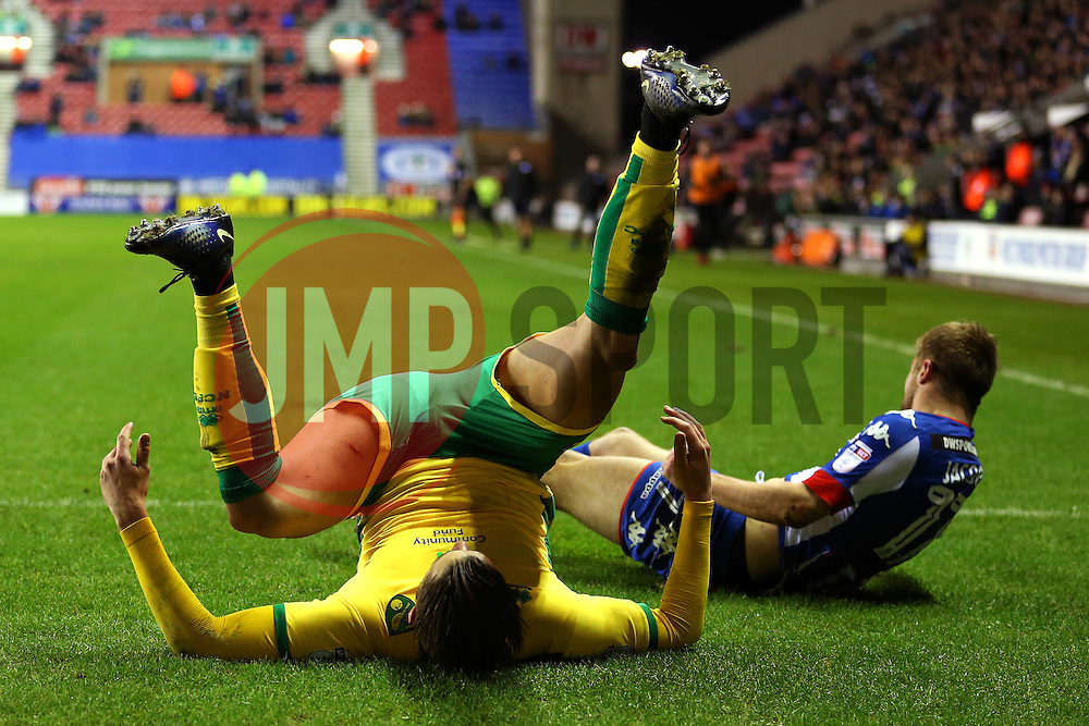 Mitchell Dijks of Norwich City takes a tumble after a tackle with Michael Jacobs of Wigan Athletic - Mandatory by-line: Matt McNulty/JMP - 07/02/2017 - FOOTBALL - DW Stadium - Wigan, England - Wigan Athletic v Norwich City - Sky Bet Championship