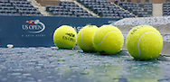 Tennis balls sit on the umpires chair  while it rain's at the USTA National Tennis Center in New York August 27, 2006. The U.S. Open starts on August 28. (Andrew Gombert for the New York Times)