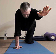 Jeff Bonsteel, from Centerville participates in a yoga class at The Studio, in Beavercreek, Thursday, March 22nd.