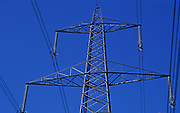 AT5BT5 Electricity pylon transmission cable lines against blue sky