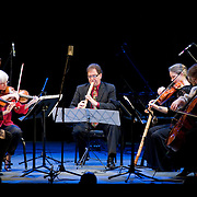 May 14, 2011 - Manhattan, NY : .James Nyoraku Schlefer (center on shakuhachi pipe) and the Colorado Quartet perform the world premiere of Carlos Sanchez-Gutierrez's 'Here, Again' during Symphony Space's Wall to Wall Sonidos concert on Saturday night. .CREDIT: Karsten Moran for The New York Times
