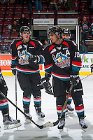 KELOWNA, CANADA - OCTOBER 21: Lucas Johansen #7 and Nick Merkley #10 of the Kelowna Rockets celebrate the win against the Tri-City Americans on October 21, 2016 at Prospera Place in Kelowna, British Columbia, Canada.  (Photo by Marissa Baecker/Shoot the Breeze)  *** Local Caption ***