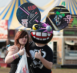 © Licensed to London News Pictures. 30/08/2015. Reading, UK.  A festival goers at Reading Festival 2015 wearing a deadmau5 at on Day 3 Sunday.  Deadmau5 is performing tonight.  Photo credit: Richard Isaac/LNP