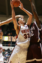 Jason Cain (33) challenges the Fordham defense in the first half.  Cain scored 16 points in the Wahoos losing effort to the Rams (62-60)...The Virginia Cavaliers fell to the Fordham Rams 62-60 at University Hall in Charlottesville, VA on December 7, 2005.