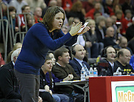 Benton Community head coach Laurie Donald encourages her team during their Rivalry Saturday game at Washington High School at 2205 Forest Drive SE in Cedar Rapids on Saturday, January 21, 2012. (Stephen Mally/Freelance)
