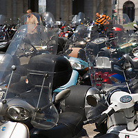 Motor scooters parked in street, Genoa, Italy