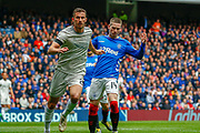 Ryan Kent of Rangers FC looks pretty disgruntled as he is forced off the ball by Shay Logan of Aberdeen FC during the Ladbrokes Scottish Premiership match between Rangers and Aberdeen at Ibrox, Glasgow, Scotland on 27 April 2019.