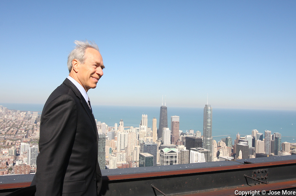 """Chicago: Robert Wislow, Chairman and CEO of US Equity Realty on one of Willis Tower's roof tops. The 110 story high Willis Tower, formerly known as the Sears Tower, is one of the tallest building in the world and the tallest building in America. Sears Roebuck and Co., once the largest retailer in the world, hired architects Skidmore, Owings and Merrill to design what would become one of the largest office buildings in the world.  In 2009 U.S. Equities renovated the 103rd floor Skydeck adding """"The Ledge"""", a glass bay that extends out from the building. .Images available in Raw files..Jose More Photography."""