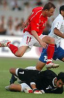 Fotball<br /> VM-kvalifisering<br /> Polen v Aserbaijan / Azerbaijan<br /> Foto: Wrofoto/Digitalsport<br /> NORWAY ONLY<br /> <br /> Tomasz Frankowski scorer for Polen forbi målvakten<br /> Jahangir Hasanzade